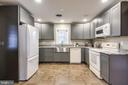 Updated country kitchen with granite countertops. - 9939 KELLY RD, WALKERSVILLE