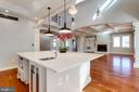Expansive kitchen island with marble top. - 120 KINGSLEY RD SW, VIENNA