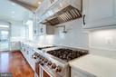 Wolf vent hood and Thor 6 burner gas stove. - 120 KINGSLEY RD SW, VIENNA