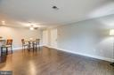 Wide-plank flooring extends throughout. - 302 GROSVENOR LN #3, STAFFORD