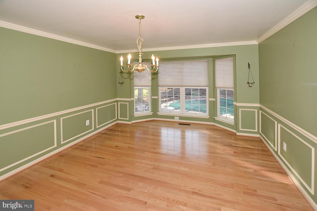 Formal Dining room with hard wood floors - 9337 S WHITT DR, MANASSAS PARK