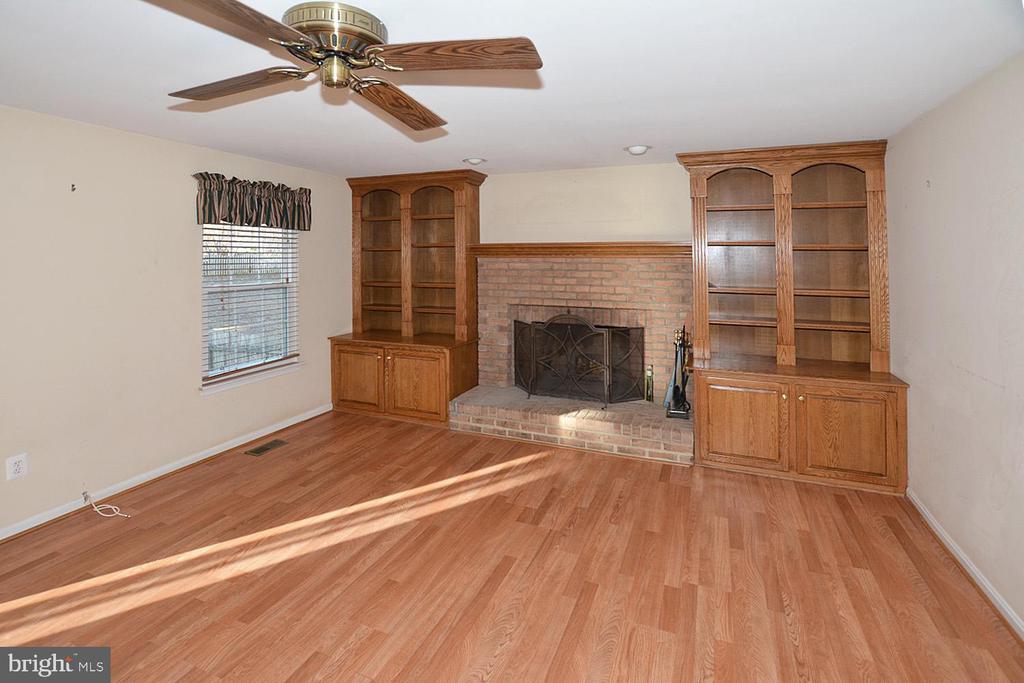 Family room has custom cabinets on each side of FP - 9337 S WHITT DR, MANASSAS PARK