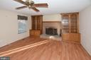 Family room has custom cabinets on each side of FP - 9337 S WHITT DR, MANASSAS PARK