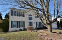 Exterior front beautiful colonial - 9337 S WHITT DR, MANASSAS PARK