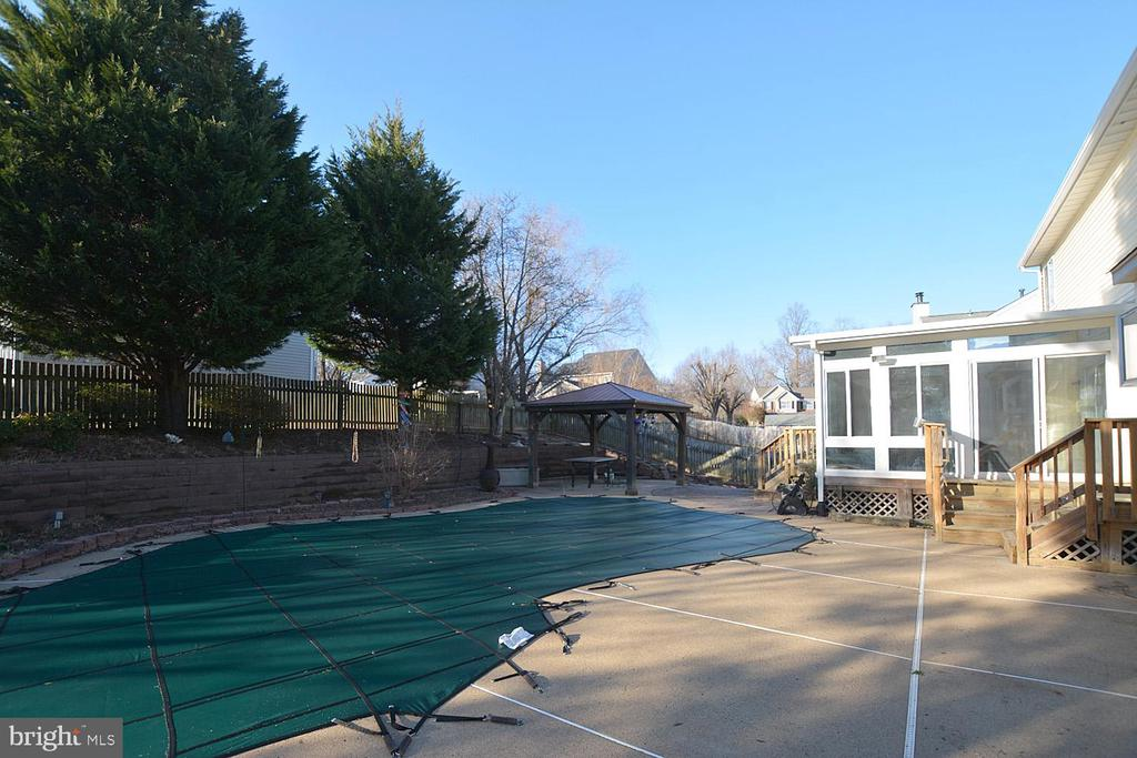 Gunnite pool, gazebo and sun room in back yard - 9337 S WHITT DR, MANASSAS PARK