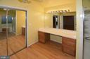 Master bath with dual sink vanity & mirror closet - 9337 S WHITT DR, MANASSAS PARK