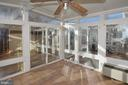 Sunroom with ceiling fan opens to pool & back yard - 9337 S WHITT DR, MANASSAS PARK