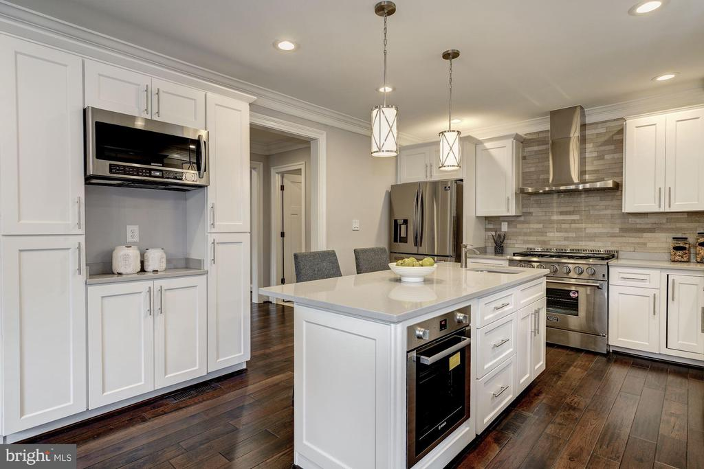 Kitchen, view of center island w/built-in oven - 6626 31ST PL NW, WASHINGTON