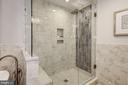 Shower in master bathroom w/ seating bench - 6626 31ST PL NW, WASHINGTON