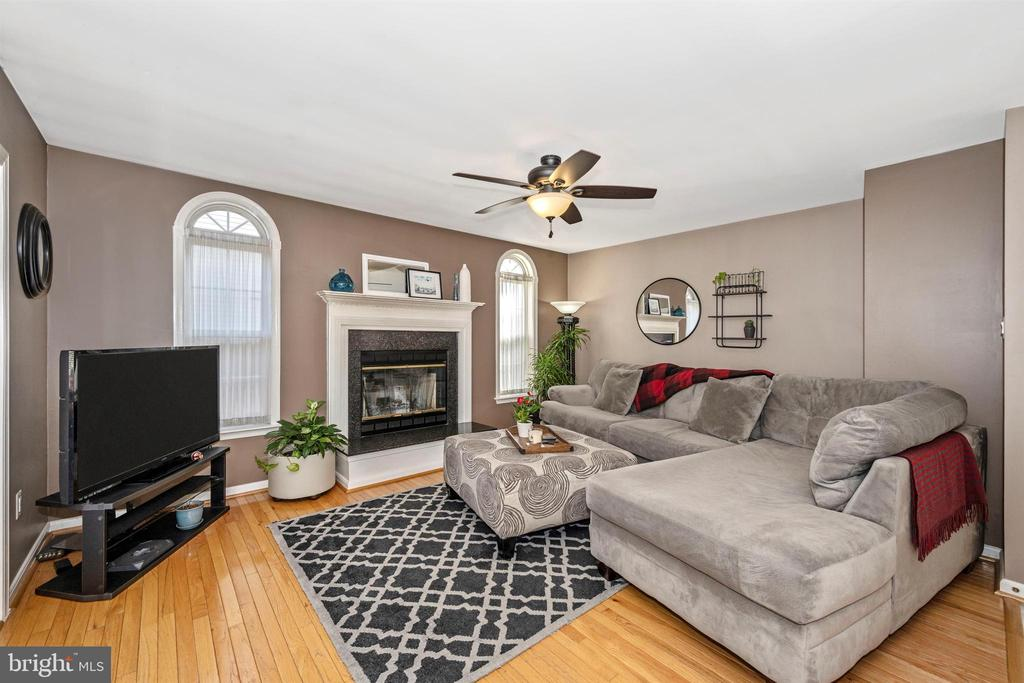 Family Room w/ Wood Burning Fireplace - 111 CROSSTIMBER WAY, FREDERICK
