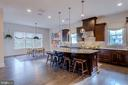 Kitchen blends seamlessly with casual dining area - 23734 HEATHER MEWS DR, ASHBURN