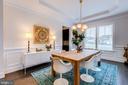 Dining room with designer light fixture - 23734 HEATHER MEWS DR, ASHBURN