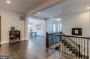Iron balusters grace the center of the main level - 23734 HEATHER MEWS DR, ASHBURN