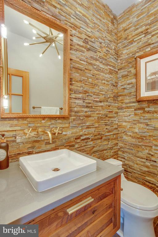 The stacked stone powder room was renovated 2017. - 12060 ROSE HALL DR, CLIFTON
