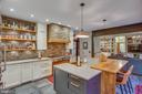 lovely ledgerstone, exotic wood, mixed metals... - 12060 ROSE HALL DR, CLIFTON