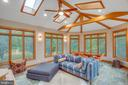 The spacious sunroom is light-filled, welcoming. - 12060 ROSE HALL DR, CLIFTON