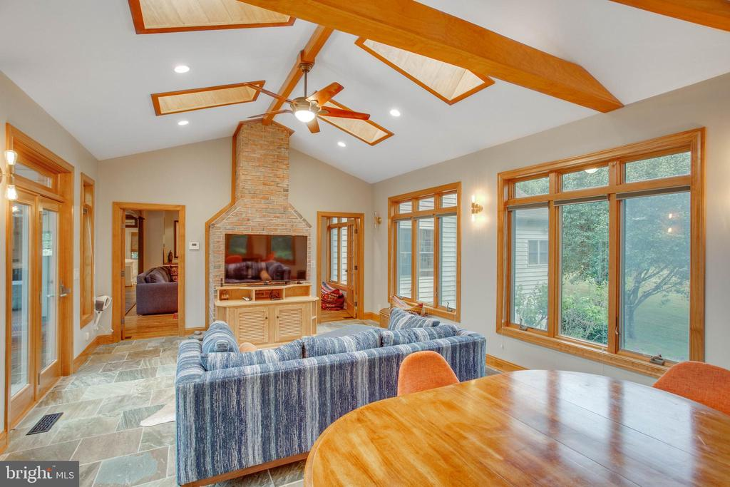 With skylights, banks of windows, and stone floor. - 12060 ROSE HALL DR, CLIFTON