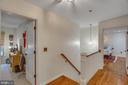 Upstairs, hardwoods continue on landing, master. - 12060 ROSE HALL DR, CLIFTON