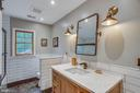 The upper hall bath, also recently remodeled. - 12060 ROSE HALL DR, CLIFTON