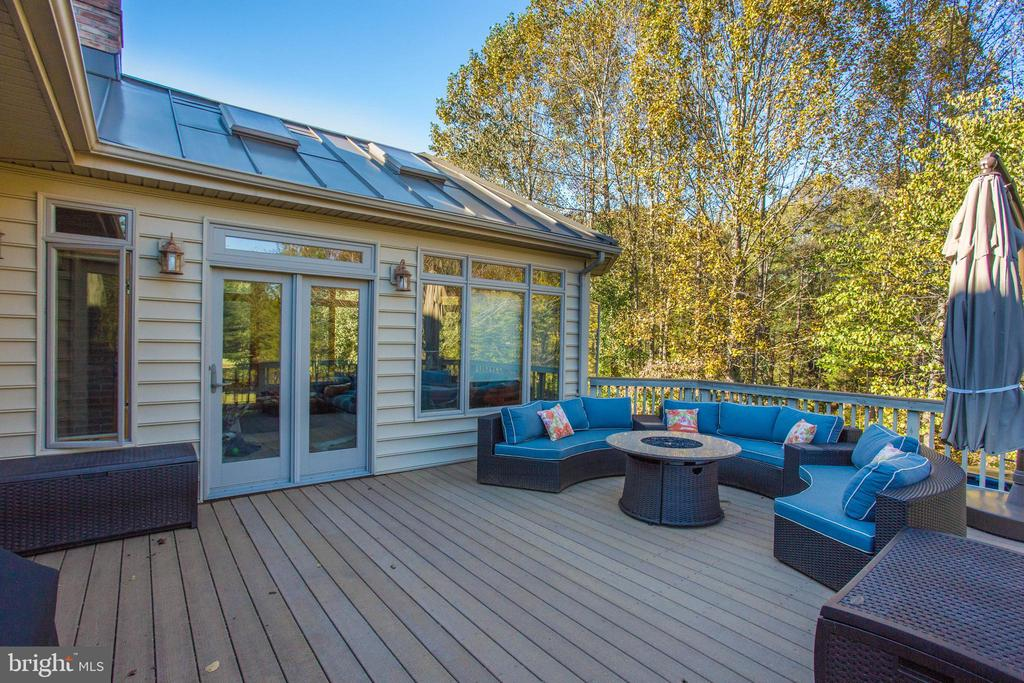 The trex deck is just right for cool nights. - 12060 ROSE HALL DR, CLIFTON