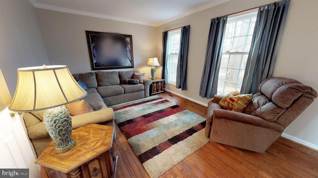 Inviting living room with hardwood flooring - 6935 COLBURN DR, ANNANDALE