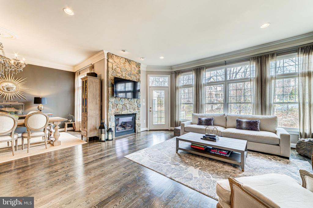 Stunning Family room with stone fireplace - 18212 CYPRESS POINT TER, LEESBURG