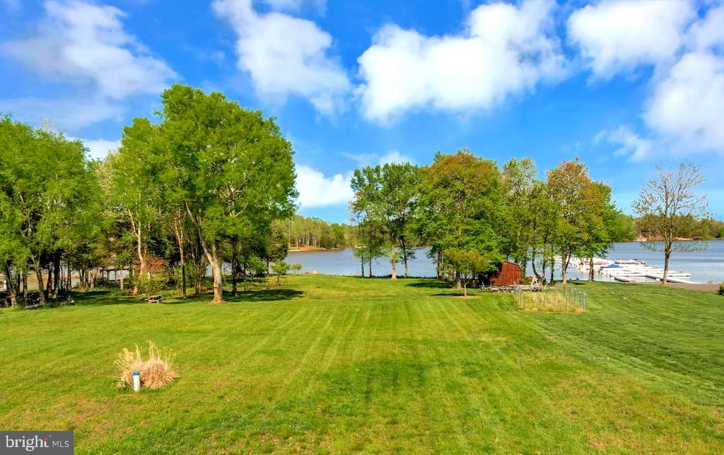 HOME SITS ON 2 ACRES & 118' OF WATERFRONT - 26515 PENNFIELDS DR, ORANGE