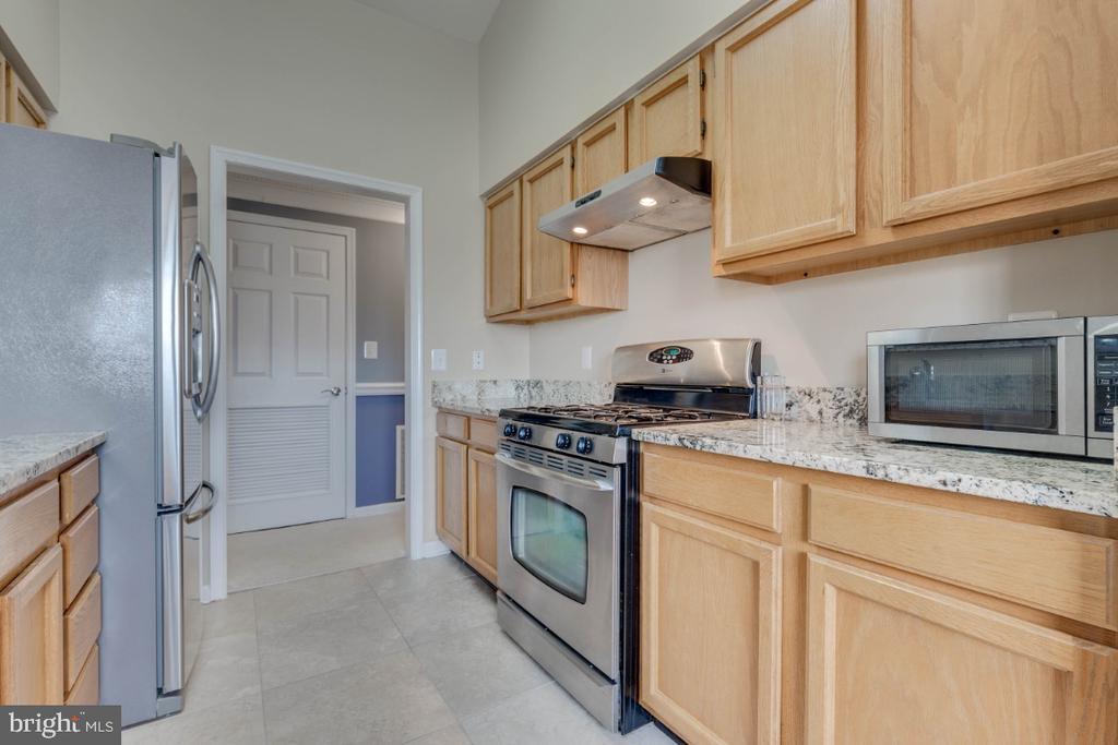 Kitchen with ceramic  floor - 10998 KOMAN CIR #304, MANASSAS