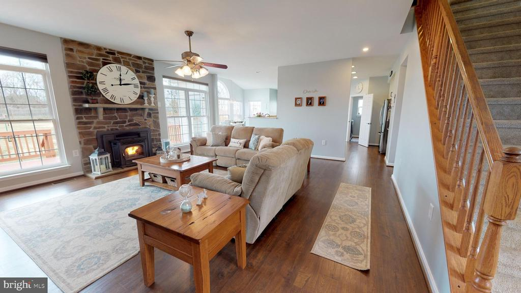 Handsome stone  fireplace with cozy pellet stove - 429 AUTUMN CHASE CT, PURCELLVILLE