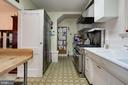 Galley Style Kitchen with Gas Stove - 5113 WESTERN AVE NW, WASHINGTON