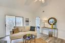 Living room  to patio and view of the woods - 11824 ETON MANOR DR #302, GERMANTOWN