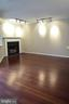 Living Room with wood-burning fireplace - 1504 LINCOLN WAY #312, MCLEAN