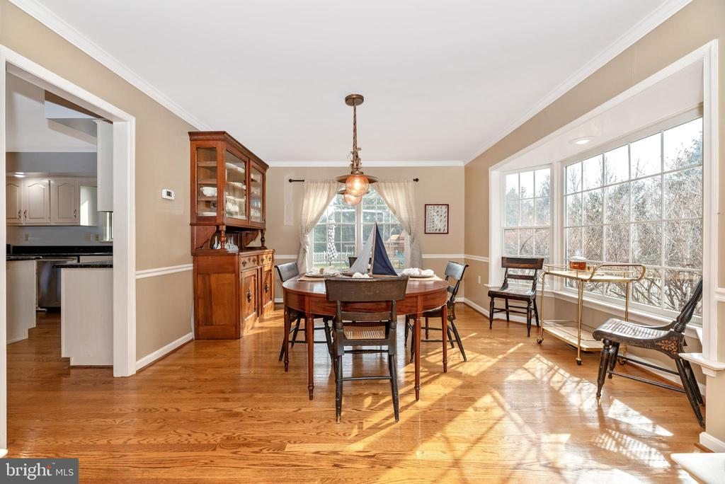 Formal dining room with natural light - 8221 FOX HUNT LN, FREDERICK