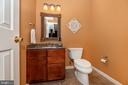 Lowe level powder room - 8221 FOX HUNT LN, FREDERICK