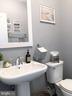 Main Level Powder Room w/Pedestal Sink - 23100 LAVALLETTE SQ, BRAMBLETON