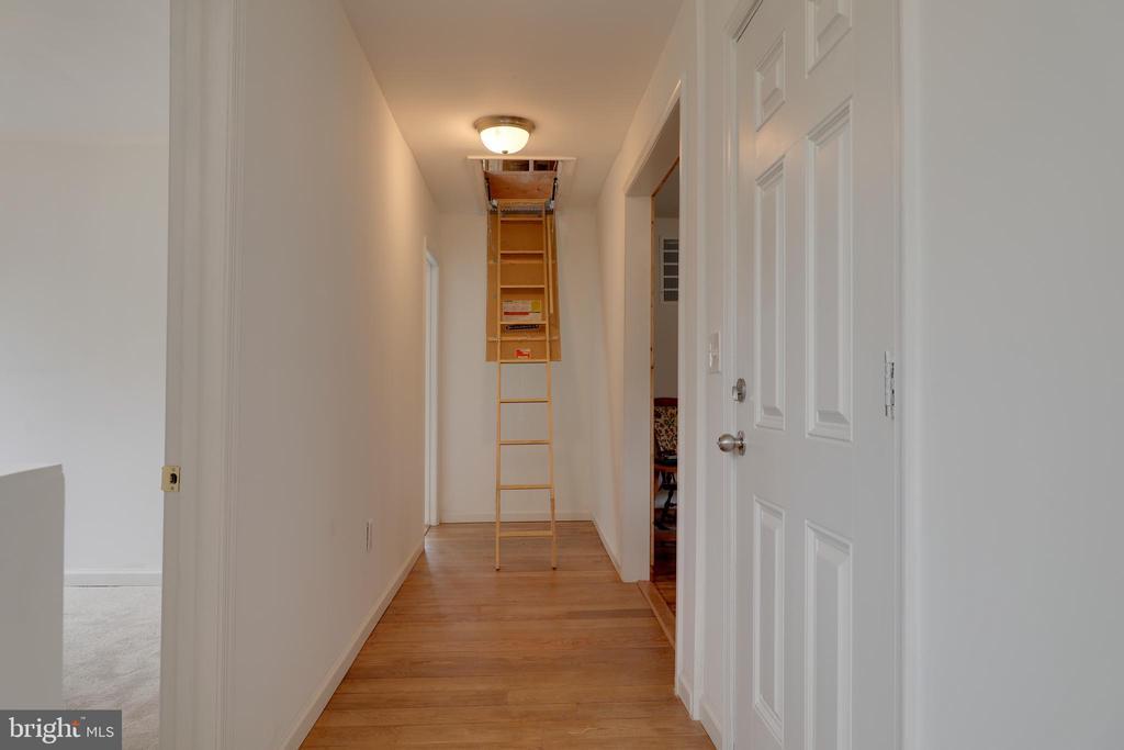 Hallway w/ attic access & new hardwood floor - 33321 CONSTITUTION HWY, LOCUST GROVE
