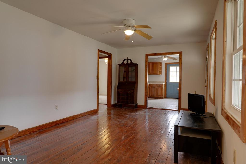 Living room w/ original wood floors - 33321 CONSTITUTION HWY, LOCUST GROVE