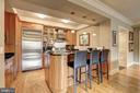 Gourmet kitchen with breakfast bar - 4821 MONTGOMERY LN #401, BETHESDA