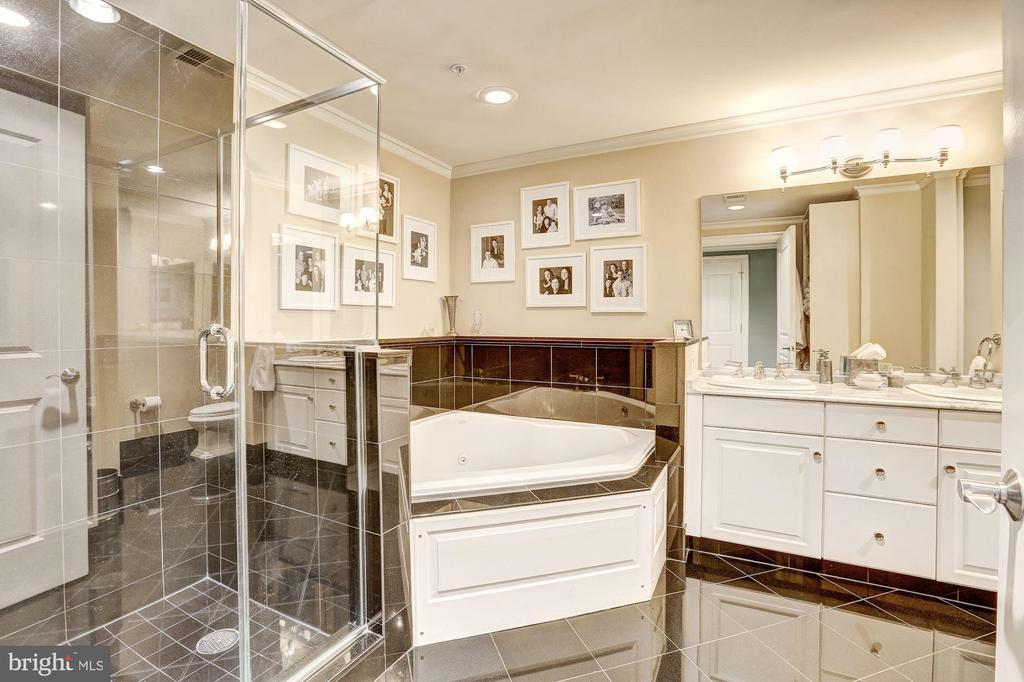 Master bath with marble floor and shower surround - 4821 MONTGOMERY LN #401, BETHESDA