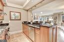 Breakfast bar opens to living and dining rooms - 4821 MONTGOMERY LN #401, BETHESDA