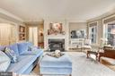 Living room with gas fireplace - 4821 MONTGOMERY LN #401, BETHESDA