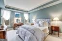 Master bedroom with tray ceiling & bay of windows - 4821 MONTGOMERY LN #401, BETHESDA