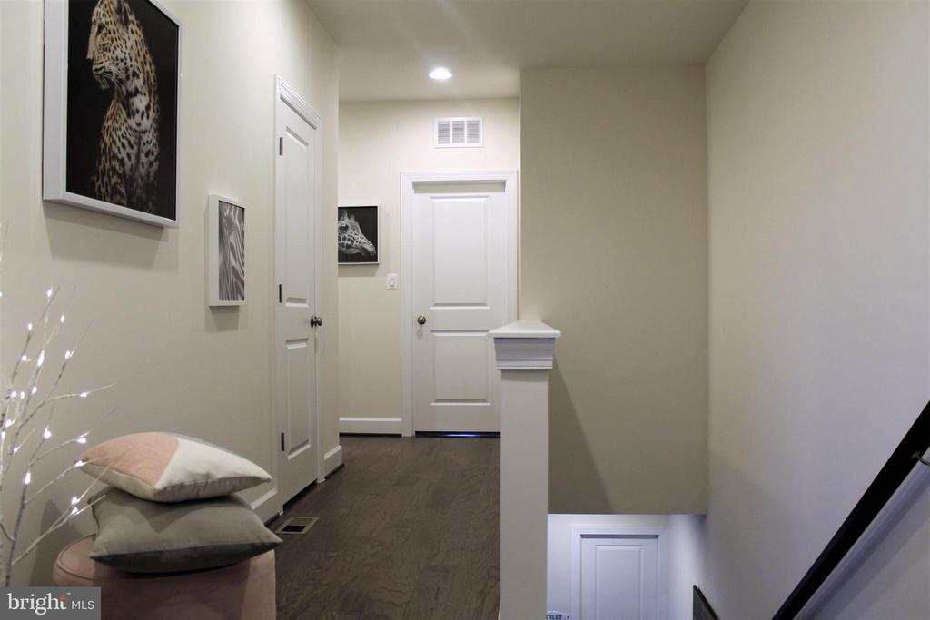Upper Level Hallway w/Recessed Lights and Hardwood - 23100 LAVALLETTE SQ, BRAMBLETON
