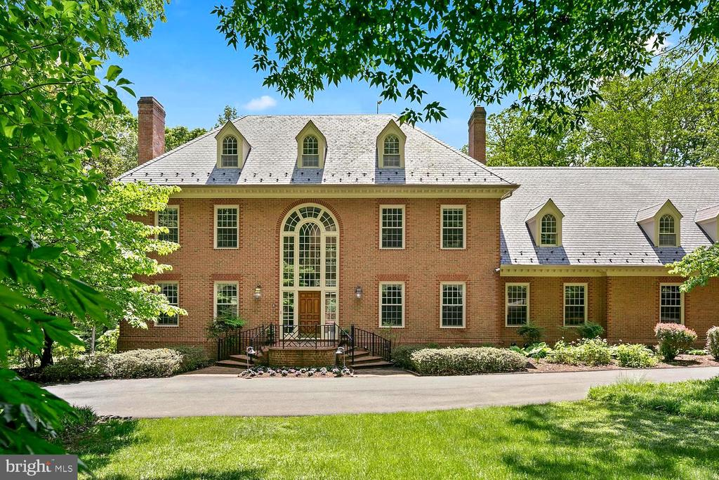 **LATE OPEN HOUSE SUNDAY 4-6 PM 9/15** Don't miss this opportunity to buy the best deal in Northern Virginia with this Large Price Reduction of 250K and now 600k below the tax assessment** A light-filled Williamsburg styled Colonial Revival mansion on a quiet country lane in Clifton, Virginia, is a picture-perfect, large three-story, brick house with another level below-grade, and has about 12,000 square feet of living space. The home has seven bedrooms, seven bathrooms and two half-baths. The current owner, added a three-car garage with an au-pair suite. Other improvements included four steam humidifiers, a whole-house vacuum system, two tankless gas water heaters, and extra attic insulation. Additionally, they installed a whole-house generator that can power the entire property including the pool.  An Otis elevator to all 4 levels. Come see this grand Southern facing Estate home that is only 2 miles from Interstate 66.