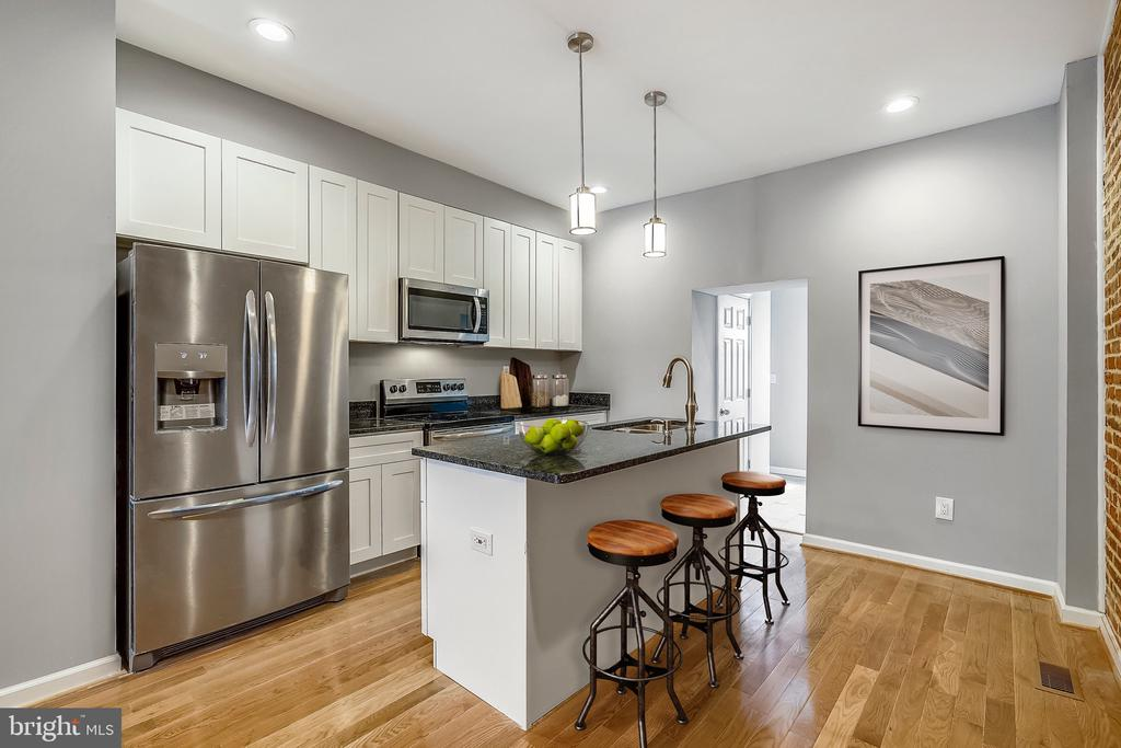 Beautifully renovated from top to bottom. Gourmet kitchen, tiled bathrooms, gleaming hardwood flooring, huge fully finished basement, bluetooth technology in speakers of bathrooms and so much more! Amust see. Close to everything!