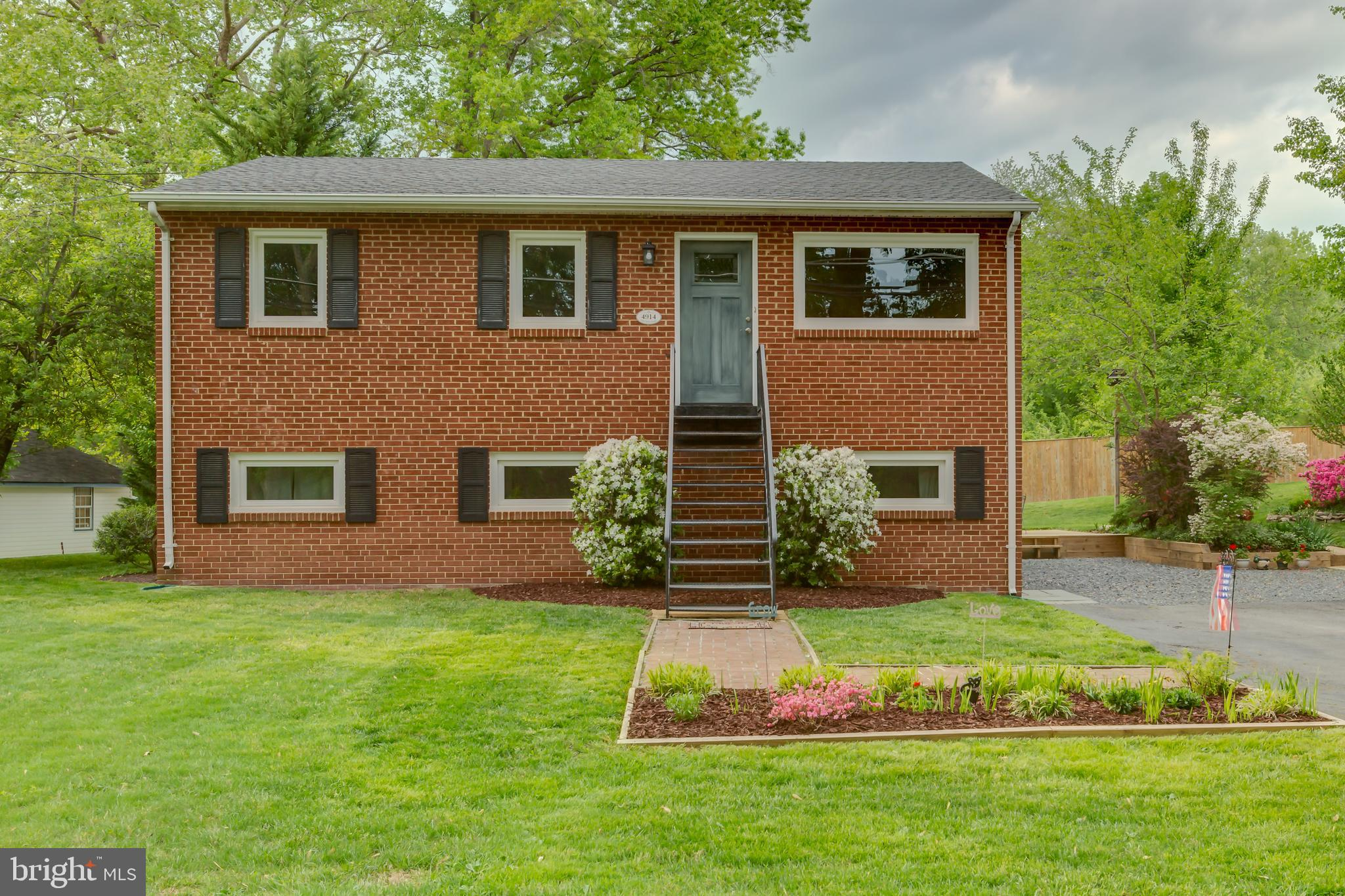 You~ll be impressed by this nicely maintained and updated brick home in Mount Vernon located on over a half-acre lot across from the Mount Vernon County Club.  Beautifully landscaped yard with fruit bearing trees and plenty of space to add an addition or garage.  Enjoy spending time in the large sunroom with newly installed roof in 2019 and separate heating/cooling unit and wood-burning stove. Updates within the last year include beautifully refinished hardwood floors on upper level and newly installed vinyl plank flooring in the basement, renovated bathrooms, new windows, new water heater, new furnace, freshly painted throughout, LED recessed lighting throughout, new washing machine. Roof replaced in 2016. Large shed with electric and a porch. Lower level with separate entrance would be ideal for in-laws or to share with a tenant or roommate. Owners boast that the huge over-sized driveway can fit 12 cars! Close to Ft. Belvoir, GW Parkway, and commuting options.  Home warranty included!
