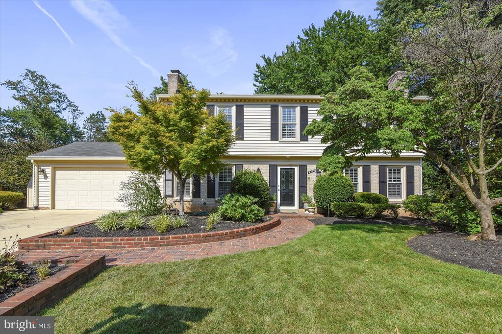 Rarely available center hall colonial in Vienna on a cul-de-sac with 5 bedrooms upstairs & hot tub/pool! Beautifully updated with wainscoting throughout the main and upper levels, hardwood floors, crown molding, plantation shutters and recessed lights. Living room features wood burning fireplace, Dining room overlooks the kitchen with white shaker slow close cabinets, granite counters, stainless steel appliances, desk space, walk-in pantry. The eat-in space leads to an enclosed sunroom overlooking the pool, hot tub and patio. The kitchen also leads to the mudroom/laundry room and 2-car garage. Upstairs the master bedroom features 2 spacious Elfa closets, en-suite bath with shower, and extra vanity. Each of the other large 4 bedrooms has overhead lighting, custom closets, plantation shutters, and hardwood flooring. There is a hallway linen closet and pull down attic. The basement is a walk-out  with a full bar - perfect for pool guests! The large rec room features custom built-ins and recessed lighting. There is a small room, currently used a playroom, that leads to the utility room with tons of storage space and 2016 HVAC and 2012 water heater. The pool and hot tub come with a new pool fence, patio, and side yard. There's a storage shed outside of the garage. The Waverly neighborhood feeds to Wolftrap, Kilmer and Madison HS. The neighborhood has Halloween block parties, book club, a path to award winning Clarity, and one of the best sledding hills in town. Enjoy Vienna events like ViVa Vienna, Chillin on Church, Oktoberfest, Church St Stroll, and so much more!