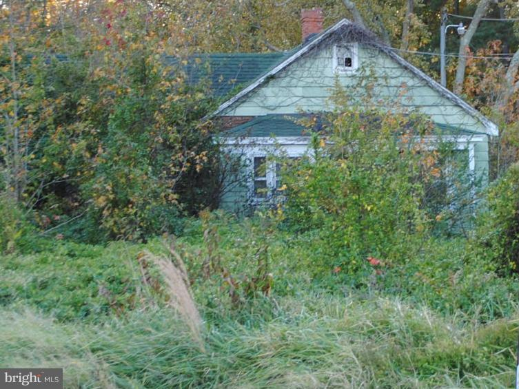 REDUCED PRICE!! Great country location. There is a septic on the property. Health Department approval to use it will be needed. Close to town - currently improved with a house in very poor condition - value is in the land. Health Dept. report & plat on file.