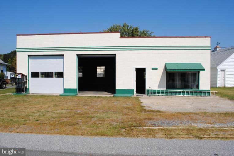 Former service station (no tanks). New bay doors, new drain system and new stone. Great storage or commercial use with easy access to Rt. 50 and all mid-shore locations. 30' x 40' building with 2 bays; (1) 20' x 20' office; (1) 20' x 20' back room & (1) bathroom.