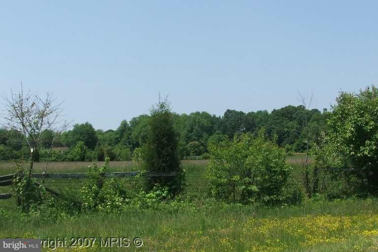 Building lot in established subdivision in Secretary. Covenants & restrictions apply.